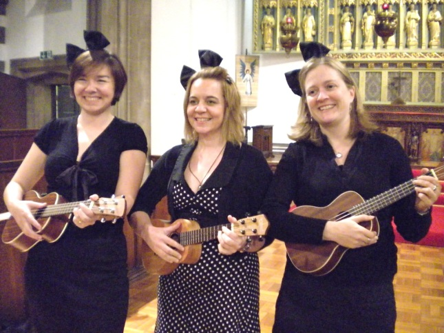 Niccola, Sara Dennis and Heather with ueks and big bows in their hair like Mickey Mouse ears